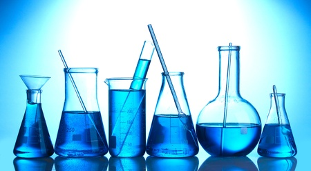 Test-tubes with blue liquid on blue background Stock Photo - 13374266