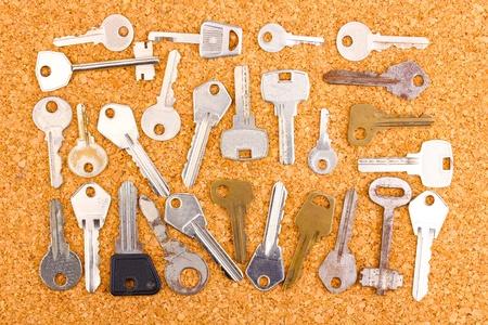 Keys on cork background Stock Photo - 13372288