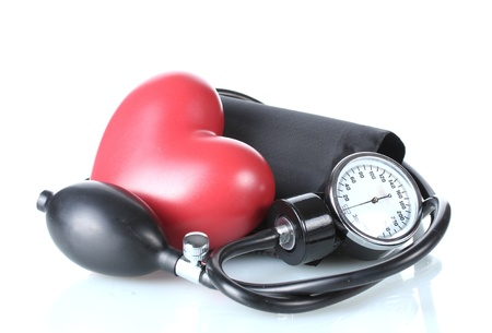 hypertensive: Black tonometer and heart isolated on white Stock Photo