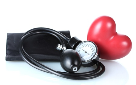 blood pressure: Black tonometer and heart isolated on white Stock Photo