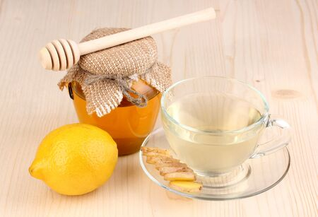 Healthy ginger tea with lemon and honey on wooden background Stock Photo - 13373895