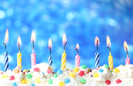 happy anniversary: beautiful birthday candles  on blue background