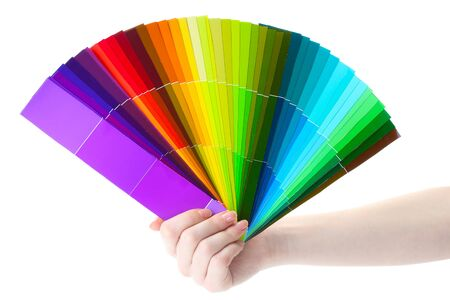 hand holding bright palette of colors isolated on white Stock Photo - 13374242
