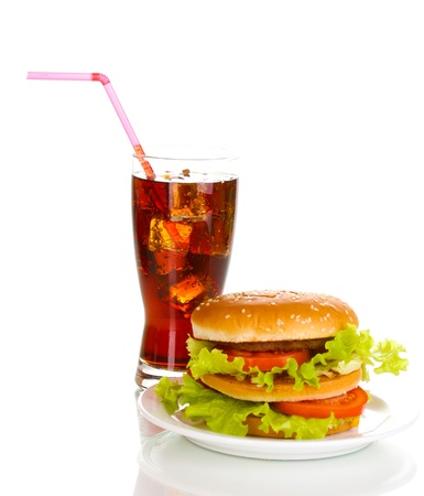 Big and tasty hamburger on plate with cola isolated on white photo
