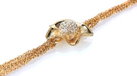 Beautiful golden bracelet with precious stones isolated on white Stock Photo - 13374681
