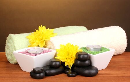 Spa setting on wooden table on brown background Stock Photo - 13373778
