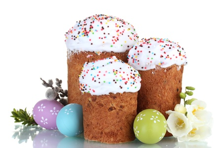 Beautiful Easter cakes, colorful eggs and flowers isolated on white photo