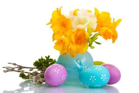 Beautiful yellow freesias in vase, Easter eggs and pussy-willow twigs isolated on white Stock Photo - 13374400