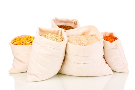 Cloth bags with grain isolated on white photo