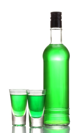 bottle and two glasses of absinthe isolated on white photo