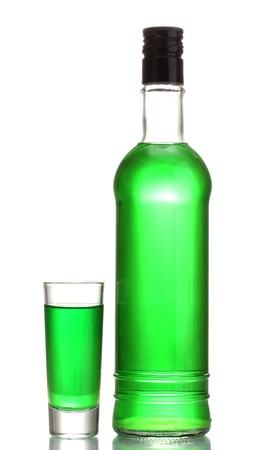 intoxicate: bottle and glass of absinthe isolated on white
