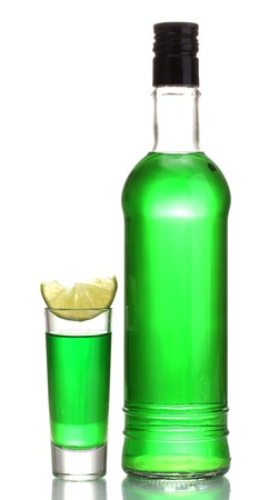 bottle and glass of absinthe with lime isolated on white Stock Photo - 13374879