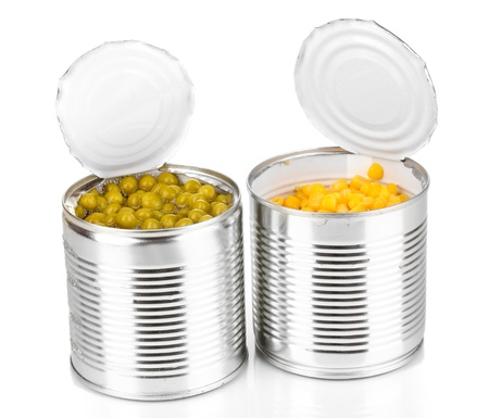canned food: Open tin cans of corn and peas isolated on white Stock Photo