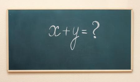 The example on the blackboard Stock Photo - 13373975