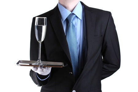 formal waiter with a glass of water on silver tray isolated on white photo