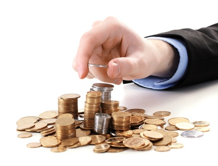 Businessman hand put coins isolated on white photo