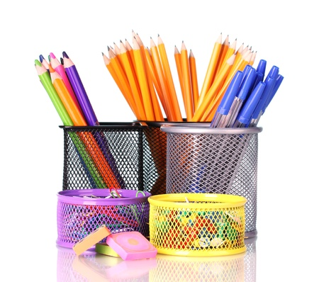 Color holders for office supplies with them on bright background photo