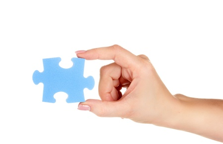 Blue puzzle with a hand isolated on white Stock Photo - 13435180