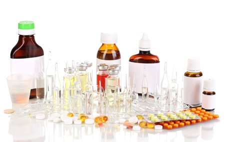 Medical bottles with medical ampoules and tablets isolated on white photo