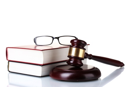 legally: wooden gavel, glasses and books isolated on white