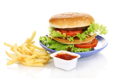 Big and tasty hamburger on plate and fried potatoes isolated on white photo