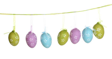Colorful easter eggs hanging on ribbons isolated on white Stock Photo - 13435031