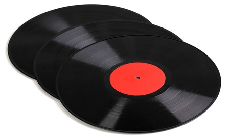 Black vinyl records isolated on white photo