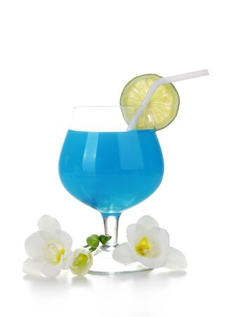 glass of blue cocktail with lime and flowers isolated on white Stock Photo - 13435036