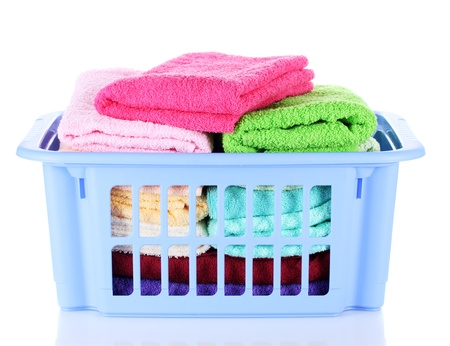 Plastic basket with bright towels isolated on white Stock Photo - 13435629