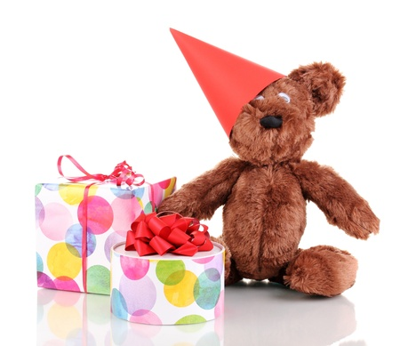 Sitting bear toy with gifts isolated on white photo
