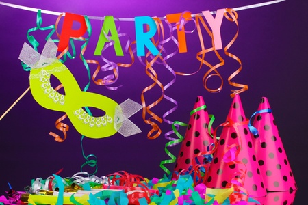 Party items on purple background Stock Photo - 13435823