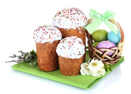 Beautiful Easter cakes, colorful eggs in basket and flowers isolated on white photo