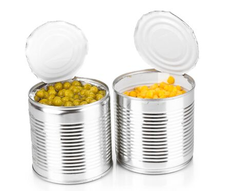 Open tin cans of corn and peas isolated on white photo
