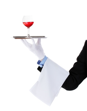 formal waiter with a glass of wine on silver tray isolated on white Stock Photo - 13435015