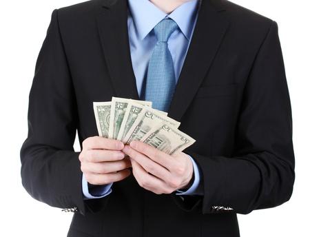 business man taking money isolated on white photo