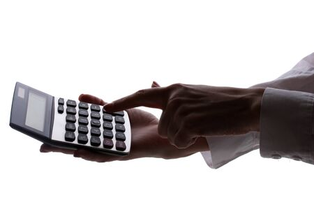 silhouette of woman's hands with calculator isolated on white   photo