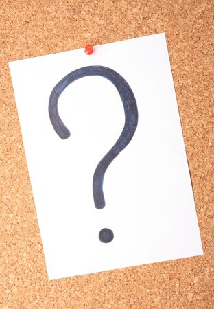 White note with question mark on cork board photo