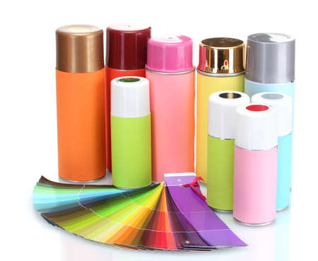 aerosol cans and bright paper palette isolated on white photo