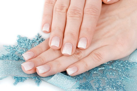 hands with beautiful winter design, snowflakes and ribbon isolated on white photo