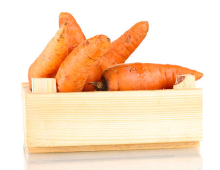 raw carrots in wooden box isolated on white Stock Photo - 13518075