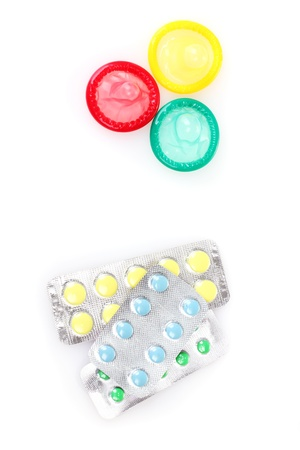 birth condoms and control pills isolated on white photo