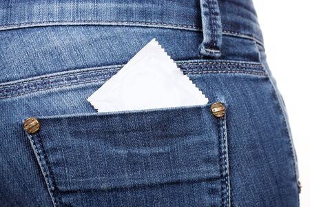 Condom in the pocket of blue jeans Stock Photo - 13514709