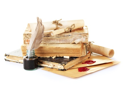 note book: old books, letters and feather pen isolated on white