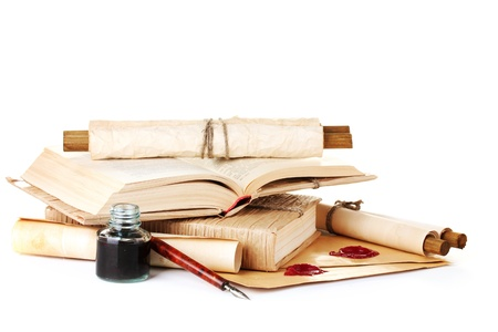 old books, ink pen and ink bottle isolated on white photo