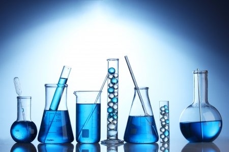 medical laboratory: Test-tubes with blue liquid on blue background Stock Photo