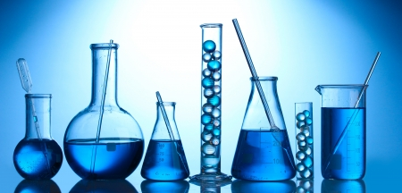 Test-tubes with blue liquid on blue background Stock Photo - 13517570