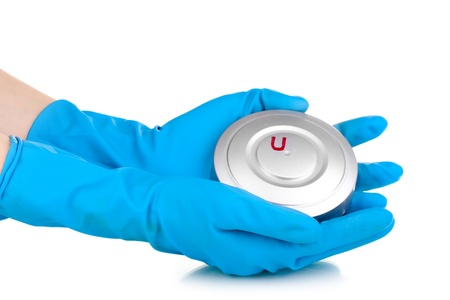 Uranium in hands isolated on white Stock Photo - 13518367