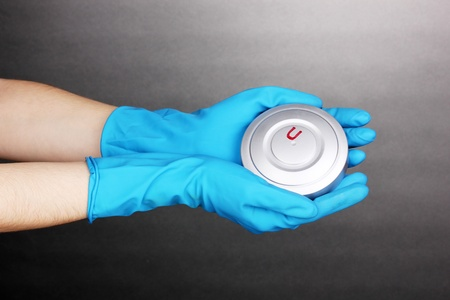 Uranium in hands on grey background Stock Photo - 13514959