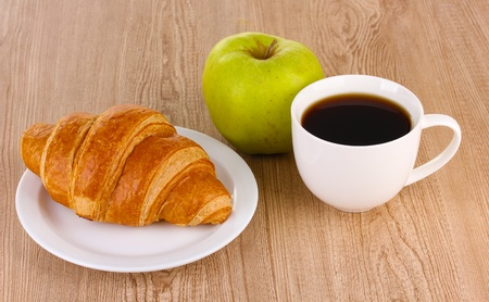 Classical breakfast. Coffee and croissant photo