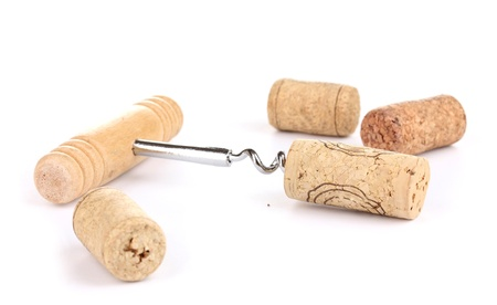 Corkscrew with wine corks isolated on white Stock Photo